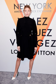 Martha Hunt kept it modest in a long-sleeve LBD by Louis Vuitton at the 'Volez, Voguez, Voyagez' exhibition opening.