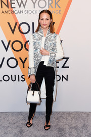 Modern T-strap sandals finished off Alicia Vikander's outfit.