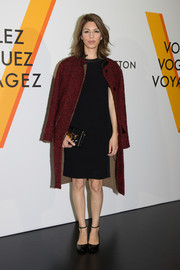 Sofia Coppola teamed a red tweed coat with a little black knit dress for the Louis Vuitton 'Volez, Voguez, Voyagez' exhibition.