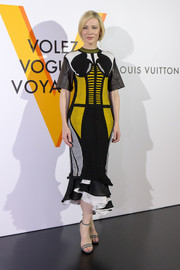 Cate Blanchett made a bold statement with this Louis Vuitton color-block knit dress with leather sleeves and a ruffle hem during the label's 'Volez, Voguez, Voyagez' exhibition.