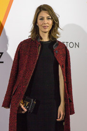 Sofia Coppola arrived for the 'Volez, Voguez, Voyagez' exhibition clutching a chic Louis Vuitton Petit Malle bag.