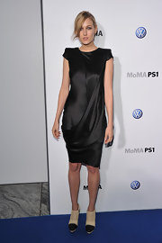 Leelee Sobieski gave her black satin cocktail dress an unexpected finish with perforated cream ankle boots with black toes.