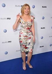 Kim Cattrall gave her sweet floral dress a flirty finish with studded ivory sandals.
