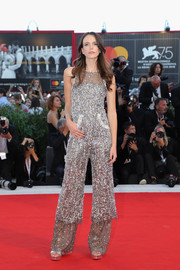 Stacy Martin attended the Venice Film Festival screening of 'Vox Lux' wearing a mega-sparkly jumpsuit.