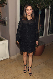 Natalie Portman attended the Vulture awards season party wearing a tiered black maternity dress by Isabel Marant.