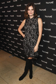Betsy Brandt styled her frock with black suede over-the-knee boots.