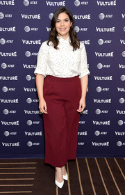 America Ferrera teamed her top with red wide-leg trousers.