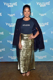 Gina Rodriguez contrasted her casual top with a dazzling gold maxi skirt, also by Vanessa Seward.