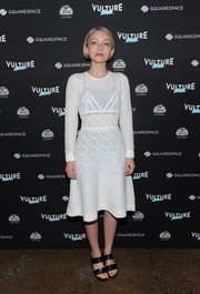 Tavi Gevinson made an appearance at the Vulture Festival wearing a mixed-pattern white sweater dress.