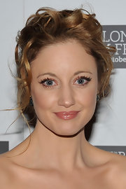 Andrea Riseborough wore her hair in a lovely mass of pinned-up curls at the 'W.E.' premiere in London.