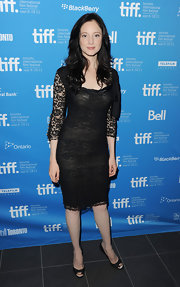 Andrea demure and elegant in a black lace cocktail dress at the Toronto Film Festival. She finished off the look with black peep-toe pumps.