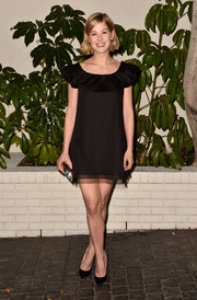 Rosamund Pike went for a cute frill-sleeved black dress for W Magazine's Golden Globes bash.