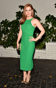 Amy Adam's was the picture of elegance at W Magazine's Golden Globes bash wearing a flattering green pencil dress.