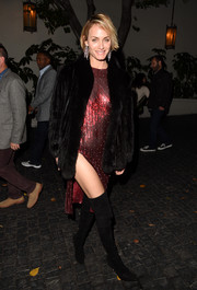 Amber Valletta didn't shy away from showing off some leg in her studded red dress, oversized coat, and thigh-high boots.