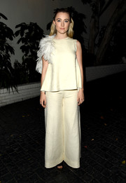 Saoirse Ronan matched her top with a pair of wide-leg pants.