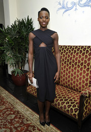 Lupita Nyong'o added a touch of print to her all-black outfit with a spotted Proenza Schouler clutch.