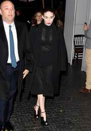 Rooney Mara looked gothic chic in a lace sheer dress that she covered with a black coat while making her way into the celebration.