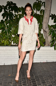 Michelle Monaghan arrived at W Magazine's Golden Globes celebration in a loose-sleeved dress with red floral accents.