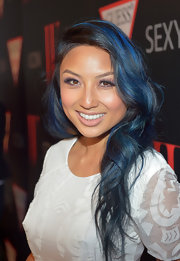 Jeannie Mai styled her long locks in soft, romantic waves for the 30 Years of Fashion and Film event.