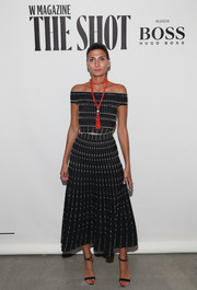 Giovanna Battaglia cut a stylish figure in a fitted black-and-white off-the-shoulder top while attending the Shot event.