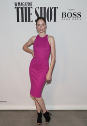 Coco Rocha brought a lovely pop of color to the Shot event with this form-fitting magenta number by Zac Posen.