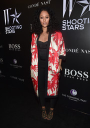 Tia Mowry attended the W Magazine Shooting Stars exhibit opening wearing a Fausto Puglisi tropical-print duster coat over a corset top and skinny pants.