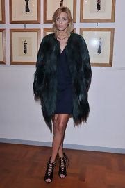 Anja Rubik layered a black fur coat over an LBD for a glam finish at the Thayaht Exhibition.