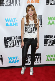 Bella showed her edgy side with a pair of black leather jeans.
