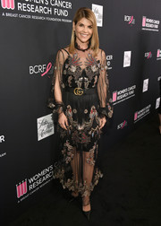 Lori Loughlin looked fabulous in a sheer, embroidered Gucci gown with a black underlay during WCRF's An Unforgettable Evening.