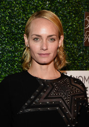 Amber Valletta wore her hair slicked down with curly ends when she attended WCRF's 'An Unforgettable Evening' event.
