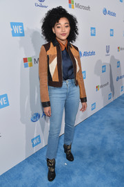 Amandla Stenberg completed her tough-chic ensemble with a pair of monochrome ankle boots.