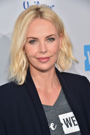 Charlize Theron made an appearance during WE Day California wearing an asymmetrical wavy 'do.