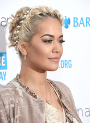 Rita Ora adorned her updo with a lovely pearl headband by Chanel.