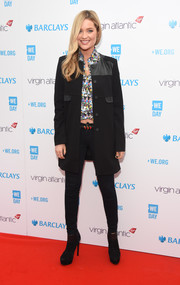 Laura Whitmore was tough-chic in a black leather-panel military coat during WE Day.
