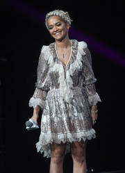Rita Ora donned a boho-meets-Victorian lace-trimmed print dress by Etro for her WE Day performance.