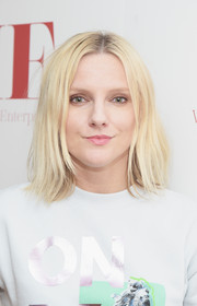 Laura Brown wore her hair in edgy center-parted layers during the WIE Symposium.