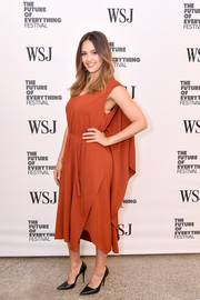 Jessica Albe looked cool and chic in a caped burnt-orange midi dress by Narciso Rodriguez at the WSJ Future of Everything Festival.