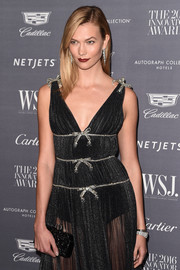 Karlie Kloss matched a sparkly hard-case-clutch with an embellished gown for the WSJ. Magazine 2016 Innovator Awards.