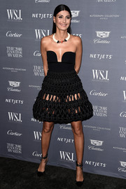 Giovanna Battaglia amped up the sex appeal with a black open-weave mini skirt by Comme des Garçons Noir Kei Ninomiya.
