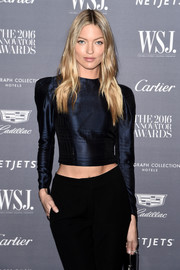 Martha Hunt attended the WSJ. Magazine 2016 Innovator Awards rocking a long-sleeve navy crop-top by Brock Collection.