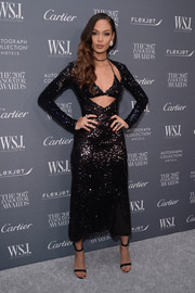 Joan Smalls finished off her outfit with a pair of black satin sandals by Christian Louboutin.
