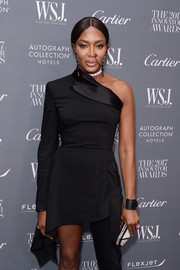 Naomi Campbell accessorized with a black cuff to match her jumpsuit at the WSJ. Magazine 2017 Innovator Awards.