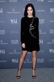 Leigh Lezark complemented her dress with black ankle-strap sandals.