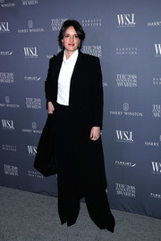 Phoebe Waller-Bridge went for a masculine-chic look in this coat and trousers combo by Prada at the 2018 Innovator Awards.