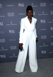 Lupita Nyong'o polished off her look with a silver clutch by Lee Savage.