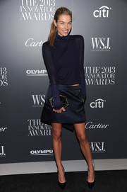 Jessica Hart covered up in cool style with a sheer navy turtleneck at the Innovator of the Year Awards.