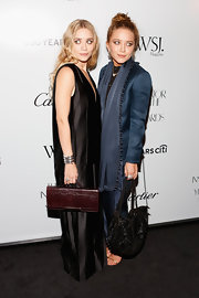 Mary-Kate Olsen's slouchy sequin shoulder bag added some sparkly to her sleek shiny blue suit.