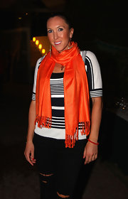 A fringed orange scarf added a bright burst of color to Jelena Jankovic's black-and-white outfit.