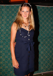 Victoria Azarenka beautifully complemented her navy sundress with a layered beaded necklace by Chanel.