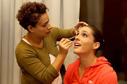 Andrea Petkovic wore her hair in a sleek classic bun while having her makeup applied at the 2011 WTA Championships.